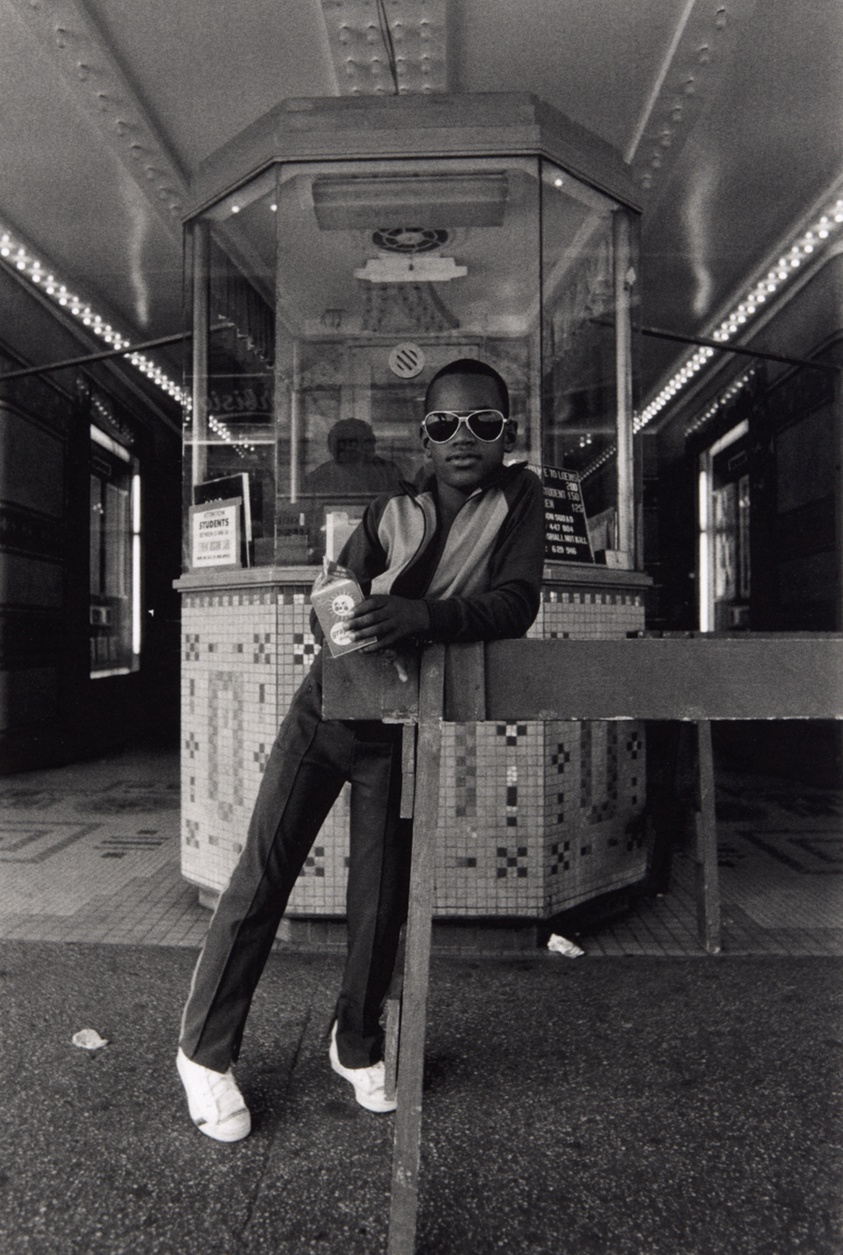 """A Boy in Front of the Loews 125th Street Movie Theater"" by Dawoud Bey"